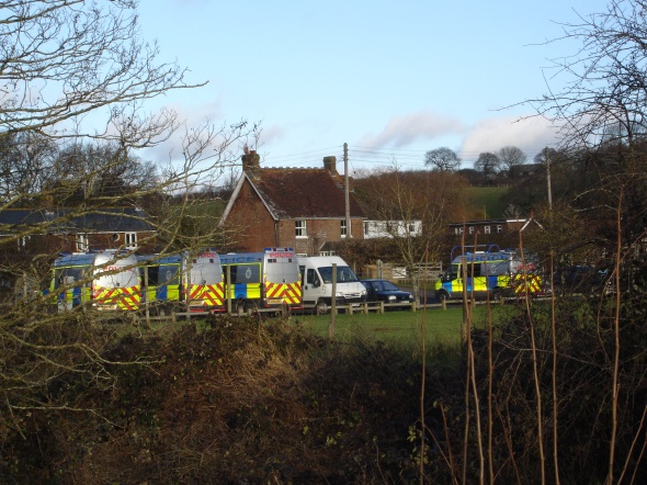 Police vans in the recreation ground car park in Crowhurst (21/12/12)