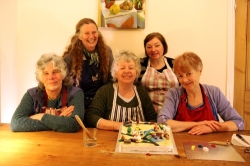 Members of Grannies Are In Action (GAIA) pose with their Regal icing traffic-jam diorama. Photo: Marta Lefler