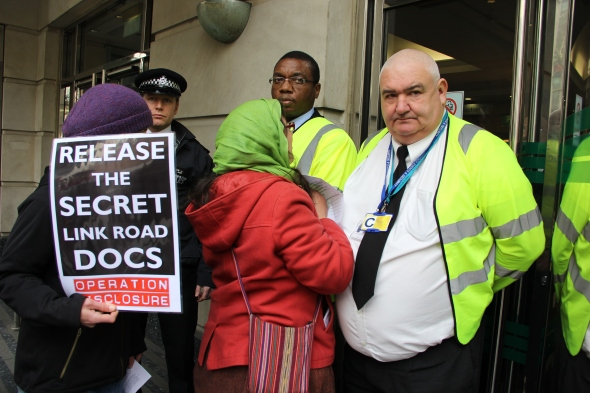 Emily Johns (centre in green scarf) attempting to enter the Department for Transport on 8 April 2013.