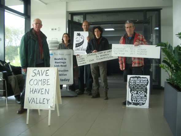"Campaigners against the Link  Road make their presence felt at the ""how we will build the road"" exhibition in Queensway, organised by East Sussex County Council and road contractors Vinci and Hochtief. Photo: Combe Haven Defenders."