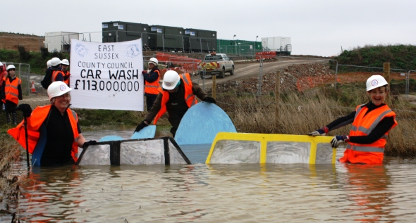 Members of Grannies Are in Action (GAIA) stage a car wash in the flood waters of Combe Haven, 12 January 2014.