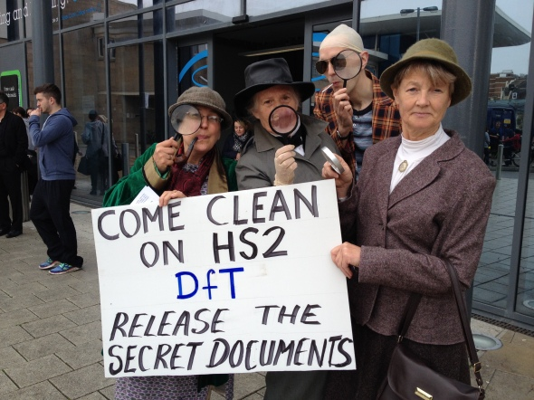 Sherlock Holmes, Insp Poirot, Kojak and Miss Marple search for secret HS2 documents at rail summit in Hastings, 31 Mar 2014 (credit: Combe Haven Defenders)