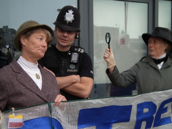 Miss Marple and Inspector Poirot (and a policeman) search for secret HS2 documents at rail summit in Hastings, 31 Mar 2014 (credit: Combe Haven Defenders)